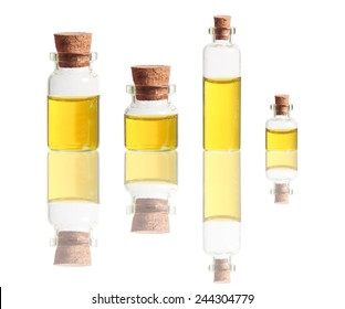 yellow liquid in bottles with cork isolated on white background