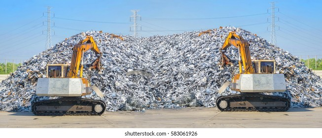 Yellow loader is operating. Focus on yellow loader. Recycling industry. Business Recycling.