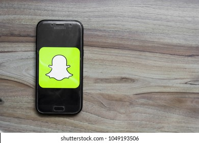 The yellow logo of the snapchat application on the screen of a Samsung phone. March 2018 in Rzeszow, Poland