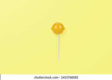 Yellow lolipop on yellow pastel background.sweet candy concept