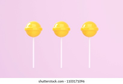 yellow lolipop on pink pastel background. sweet candy concept