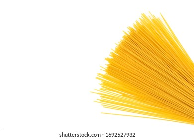Yellow long spaghetti isolated on White background. Thin pasta arranged in rows. Yellow italian pasta. Long spaghetti. Raw spaghetti wallpaper. Thin spaghetti. Food background concept.