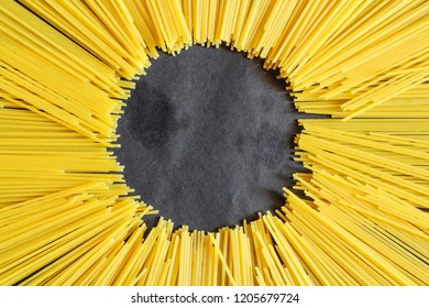 Yellow long spaghetti on a rustic background. Yellow italian pasta. Long spaghetti. Raw spaghetti bolognese. Raw spaghetti , Food background concept.