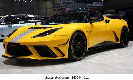 Yellow Lotus Evora Mansory custom sports car with silver details in Geneva Switzerland March 2019. Mansory creates beautiful, powerful and unique custom cars, focusing mostly in British luxury cars.