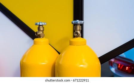 yellow LPG gas bottles