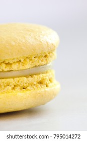 Yellow macaroon on the light background