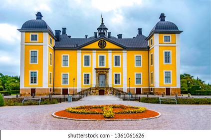 Yellow mansion entrance landscape. Yellow mansion garden view. Yellow mansion landscape. Yellow mansion house