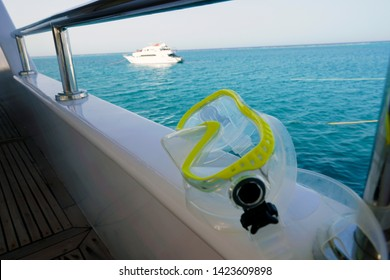 yellow mask, a gear for scuba diving or snorkeling is seen on the deck of a live aboard diving tour boat, a nice choice of an extreme summer sport to discover undersea world