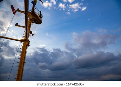 yellow mast of the ferryboat, cloudly weather background, turkish flag on the mast.
