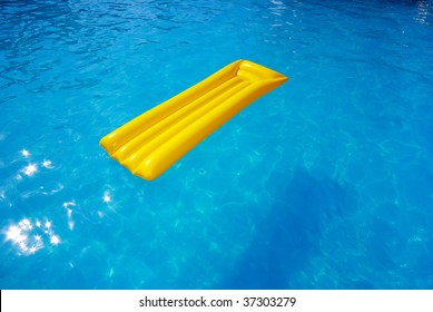 yellow mattress in the swimming pool sunny day