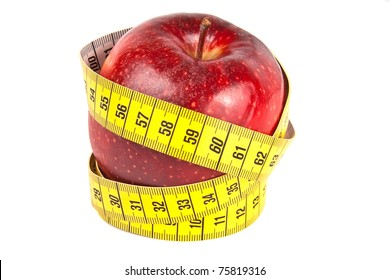 Yellow measuring tape around fresh red apple isolated on white