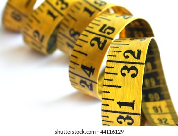 Yellow measuring tape isolated over a white background.
