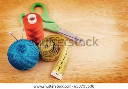 yellow-measuring-tape-scissors-threads-4