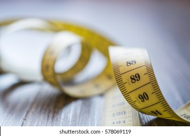 Yellow Measuring Tape of the Tailor. Selective Focus.