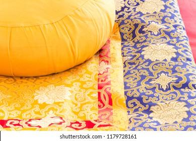 yellow meditation cushion