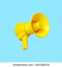Yellow megaphone loudspeaker on a blue background