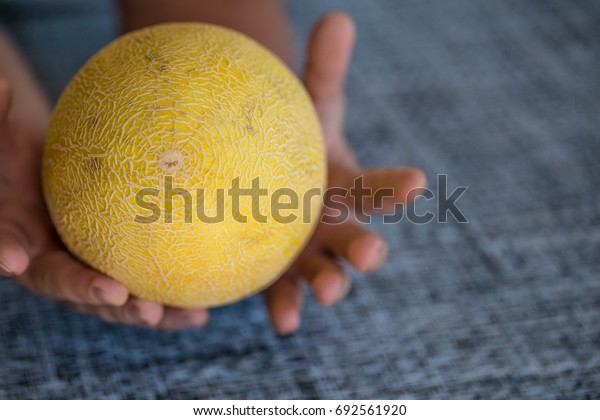 Yellow Melon in Hands