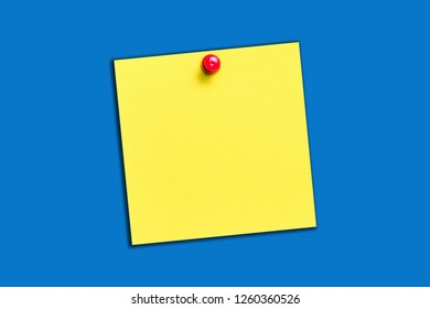 Yellow memo card with red pin. Note paper empty copy message space isolated on blue with shadow.