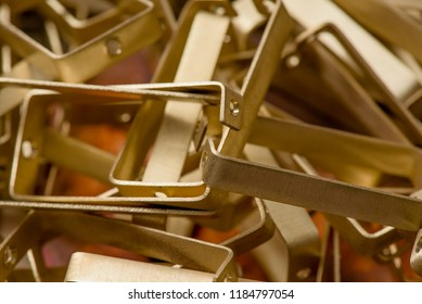 yellow metal from brass. remnants of brass processing after punching. Textural background. brass details close-up