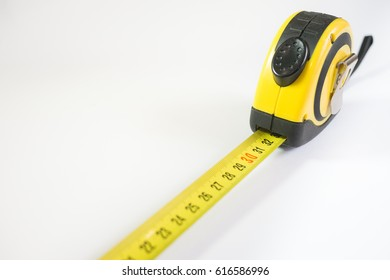 Yellow metal construction meter on a white background.