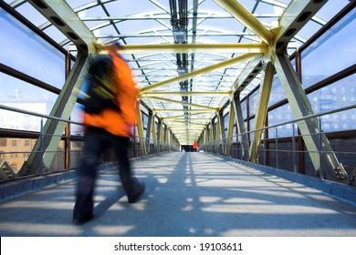 Yellow metal corridor with windows, crowd mooving