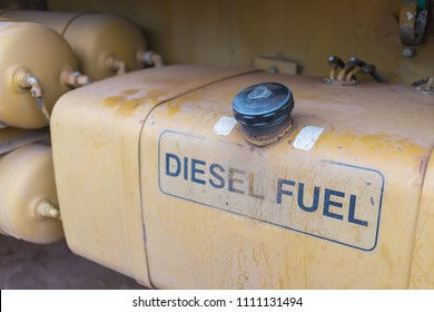 Yellow metal fuel tank of big truck.