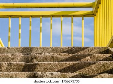 Yellow metal guardrail on the bridge