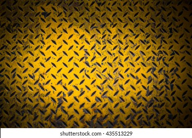 yellow metal sheet with dark vignette free copy space for text, grunge steel background,