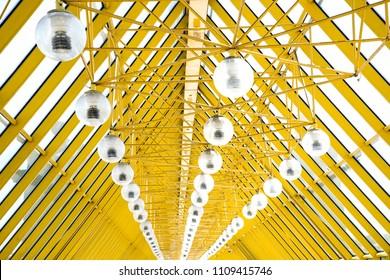Yellow  metal structure of a bridge.  Andreevsky pedestrian bridge , Moskow.