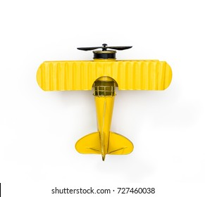 Yellow Metal toy vintage plane isolated on white for Children Fun Air Travel concept Top view Flat lay