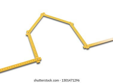 Yellow meter ruler folded as house on white background