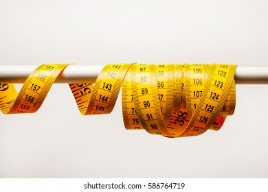 Yellow meter tape measure on a white background. Yellow Tape Measure on white background. Image of yellow centimeter on a white background. Horizontal image. Horizontal orientation.