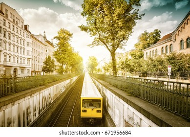 yellow metro train in Berlin Prenzlauer Berg
