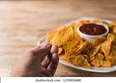 yellow mexican nachos chips on the table