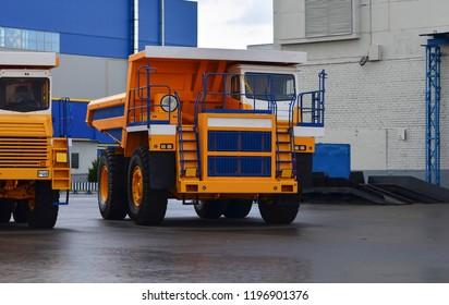 Yellow mining truck. Supersize car.  Tipper. Belaz. Career.