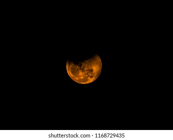 Yellow moon or Supermoon or Newmoon or Fullmoon in the dark sky during night time with full of clouds.