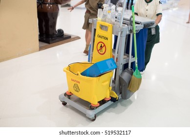 Yellow mop bucket and set of cleaning equipment