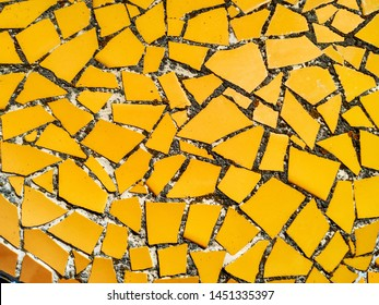 Yellow mosaic wall decorative ornament from ceramic broken tile.