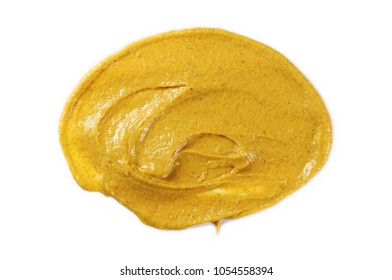 Yellow mustard sauce, spread isolated on white background, top view
