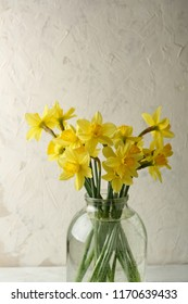 Yellow narcissus flowers in glass jar