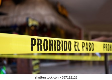 Yellow no cross tape with sign - Prohibido El Pasa