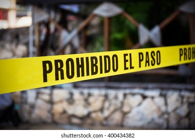 Yellow no cross tape with sign - Prohibido El Pasa