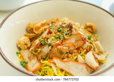 The yellow noodles mix pork with red meat and some vegetables are popular to eat in Asia