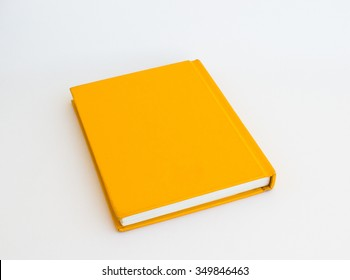 Yellow notebook on white background