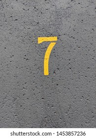 Yellow number seven on blacktop