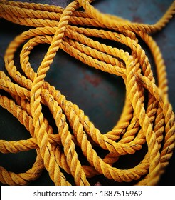 Yellow nylon rope. Rope made of nylon is most appreciated because it is very stretchy.