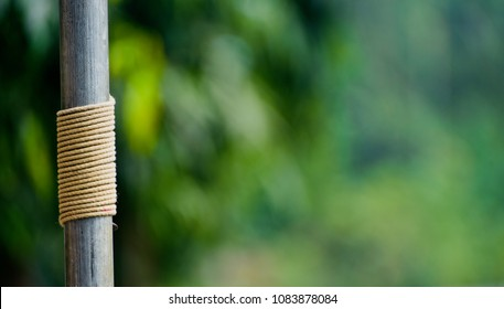 Yellow nylon rope is tied with a metallic pipe isolated object unique stock photo