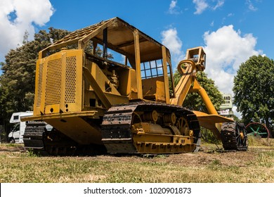 Yellow old bulldozer used to pull large logs out of the forest.