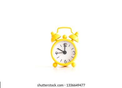 yellow old retro clock  on white background
