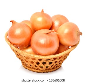Yellow onion in the basket isolated on white